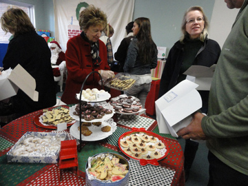 What shall I buy? Customers are spoiled for choice at Child & Family's Annual Cookie Walk.