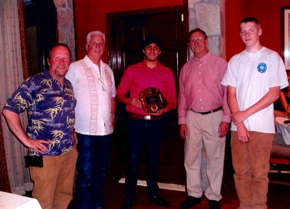Celebrating Erick's award are, from left to right, Bob Morin, member of the Lyme Fire Company and fiance of Robin Courtney, Erick's host mother; Jamie Leatherbee, 1st Assistant Chief of Hamburg; Erick Saenz; Tom Brown, Fire Chief; and Austin Courtney, member of the Lyme Fire Company and Erick's host brother.