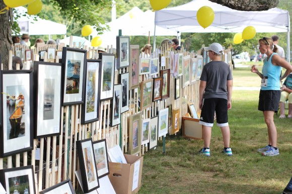Enjoy the artwork of the 'Plein Air' artists in front of Center School.