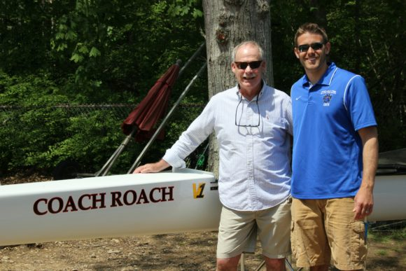 Rob Roach stands with LOLHS Varsity Coach Louis Zubek by the 'Coach Roach.'