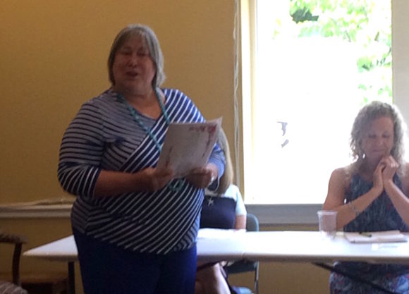 Ann Roy read a self-composed poem honoring the two outgoing Library directors.