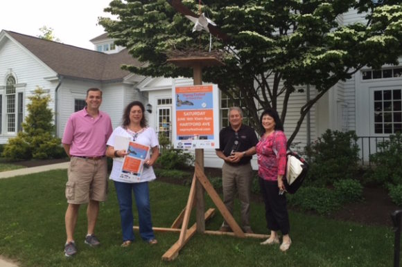 Standing by one of the osprey nests being used to promote this Saturday's Osprey Festival are board members of the Lyme-Old Lyme Chamber of Commerce (from left to right) Mark Griswold, Jan Ayer Cushing, Doug Lo Presti and Joann Lishing.
