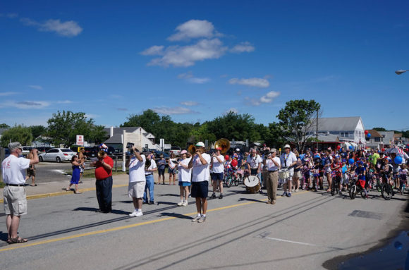 The Silver Cornet Band played the national anthem at the Hartford Ave. flagpole.