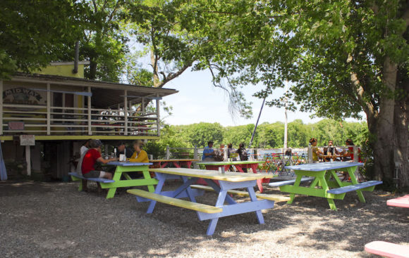 Looking across the vibrant patio of 'The Blue Oar' towards the Connecticut River.