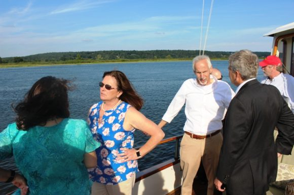 Enjoying a boat ride on the Connecticut River but still deep in discussion are (from left to right) Chester First Selectwoman Lauren Gister, Old Lyme First Selectwoman and and Connecticut Port Authority (CPA) Board Member Bonnie Reemsnyder, Essex First Selectman Norm Needleman, CPA Chairman Scott Bates and Deep River First Selectman Angus McDonald, Jr.