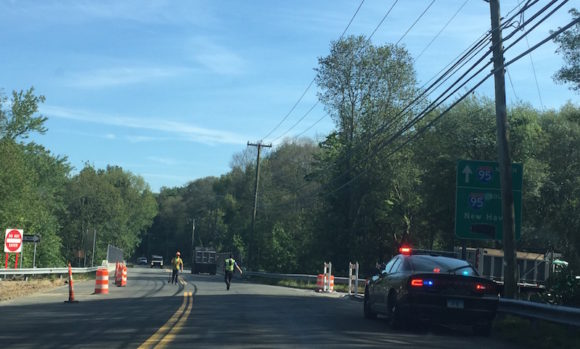 Old Lyme Police patrol the currently closed entrance to the I-95 south bound on-ramp at Exit 71 on Four Mile River Rd.