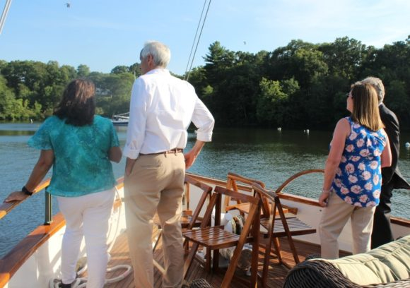 Eyes on the Cove -- guests on the 'Victoria' gaze at the view across the calm waters of Hamburg Cove.