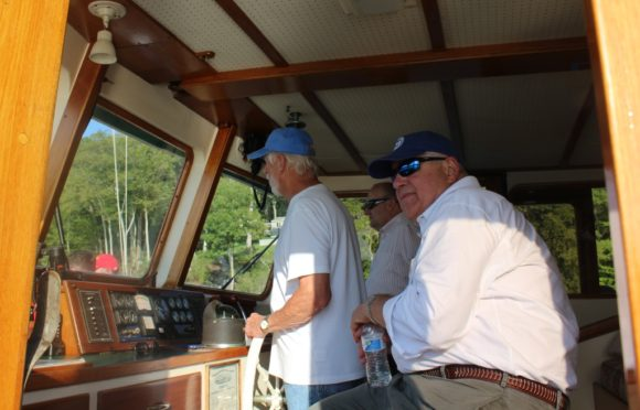 John Johnson, CPA board member (right) checks in with the captain of the 'Victoria.'