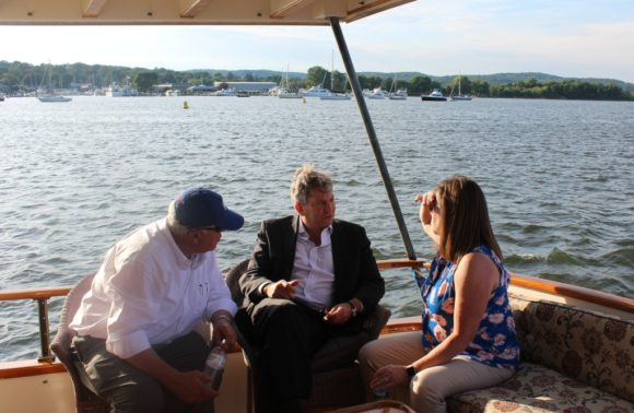 John Johnson (left) and Bonnie Reemsnyder (right), both CPA board members, chat with the CPA Chairman Scott bates.
