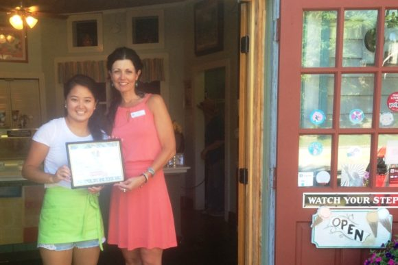 The Old Lyme Ice Cream Shoppe receives its Certificate of Appreciation from the Children's Library for supporting the Summer Reading program.