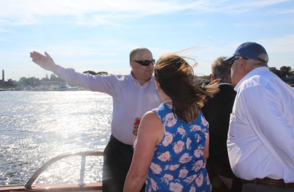 Connecticut Port Authority staff member Joe Salvatore points out a river feature to Reemsnyder and Johnson.