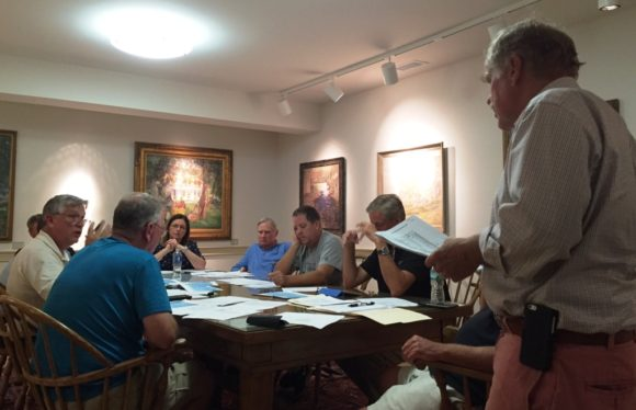 Old Lyme Town Treasurer Tim Griswold (standing) makes a point during the meeting.