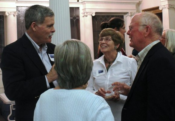 Former OL-PGN Board President Jack Collins (left) engages with library supporters.