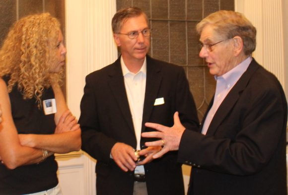 From left to right, leslie massa, Chairman of the Friends of the library, Alan Poirier, Library Board of Trustees President and David Winer, past Board President share memories of Mary's tenure.