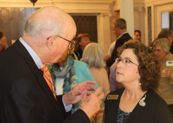 John Forbis gives his good wishes to Mary at the event.