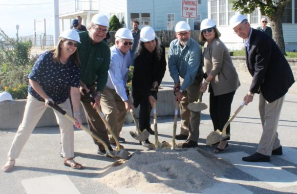 From left to right, Sound View Improvement Committee members Bonnie Reemsnyder, Frank Pappalardo, Jim Lampos, and MaryJo Nosal dig a ceremonial shovel in the sand at the groundbreaking on Hartford Ave. held Oct. 3.