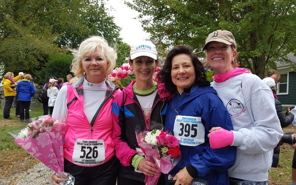Shelley Gregory (right) is often joined by friends on her fundraising walk -- and will be again this year. Julie Edmundsen stand to Shelley's left after completing the walk last year.