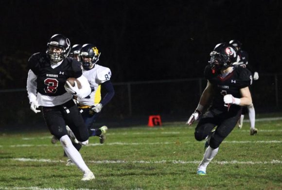 Garrett Burdick (#3) in action in last week's blow-out 31-0 victory over Haddam-Killingworth.