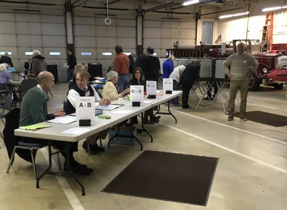 Election workers hard at work in the Old Lyme Polling Station at Cross lane Firehouse. Photo by L. Peterson.