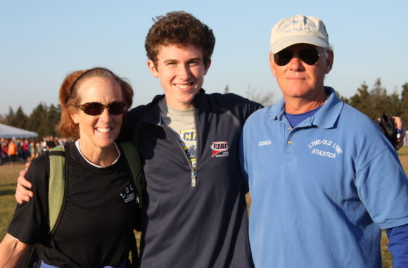 Nick stands with LOLHS Cross-country coaches Barbara O'Leary and Bill Raider in this 2011 photo.