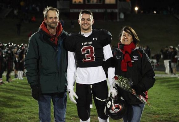 Proud parents Paul and Judy stand with their son, Lyme-Old Lyme High School senior Garrett , at Senior Night celebrations last week. Photo by Laura Matesky.