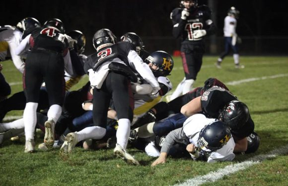 Warrior football action from the team's victory over H-K. File photo by Laura Matesky.